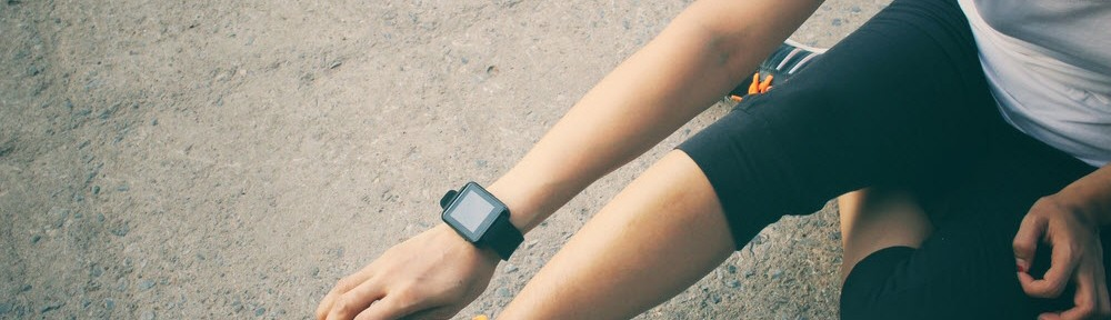 woman exercises with smartwatch